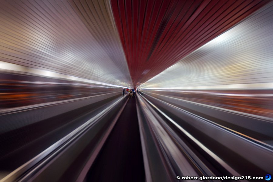 Action Photography - Moving Sidewalk, photo by Robert Giordano